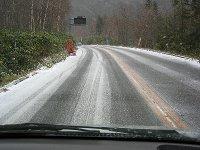 雪が積もりつつある金精峠