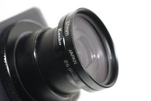 レンズガードフィルター(ハクバ、MCレンズガード、 37mm)を付けたキャノン PowerShot S110